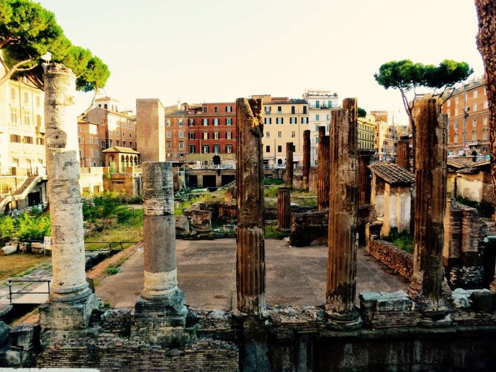Walk past the Area Sacra di Largo Argentina and the remains of 4 Republican Roman Temples and Pompey's Theatre
